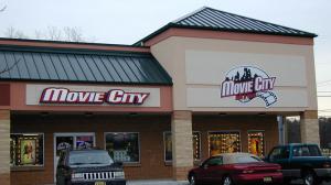backlit poly sign movie city
